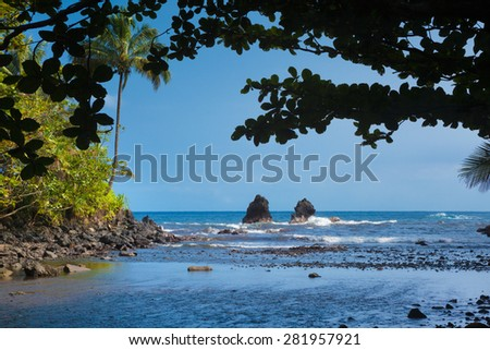 View of the beautiful shore from the tropical forest - stock photo