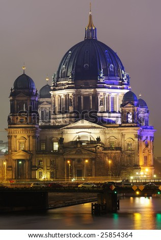View of the Berliner Dom illuminated in the night. - stock photo