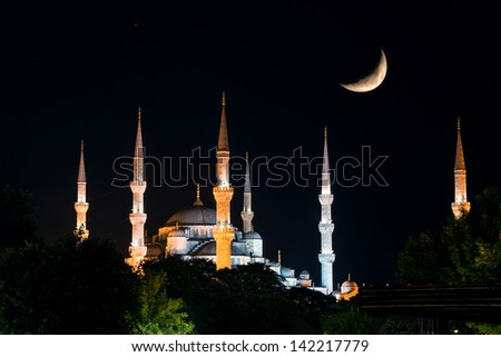 View of the Blue Mosque (Sultanahmet Camii) at night with Crescent, Istanbul, Turkey - stock photo