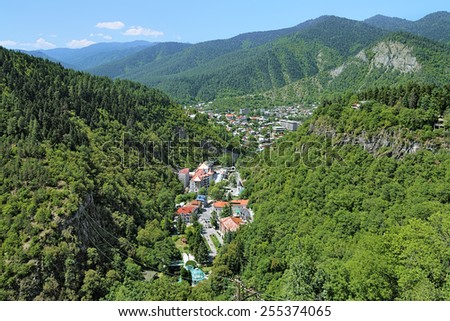 View of the Borjomi resort town from a ferris wheel in the Borjomi National Park, Georgia - stock photo