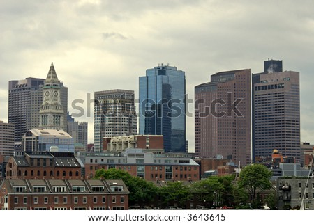 View of the boston skyline from boston harbor showing various skyscrapers from different eras.