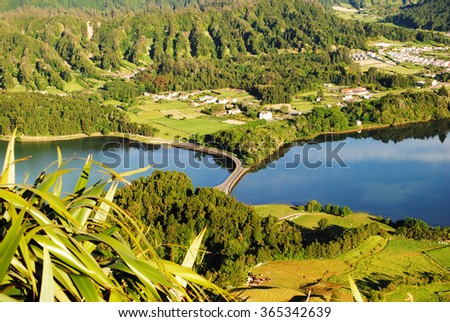 "View of the bridge in the middle of Lagoa das sete cidades (""seven cities lake""), a volcanic crater lake,  in Sao Miguel island in the Azores (Açores) archipelago - stock photo"