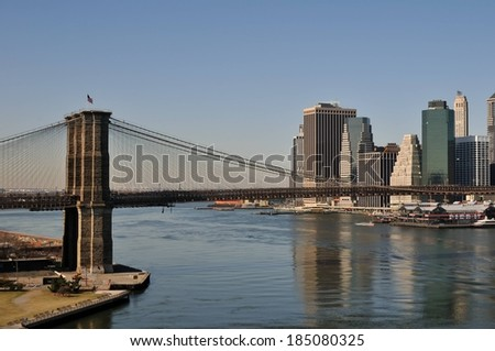 View of the Brooklyn Bridge and Lower Manhattan from the Manhattan Bridge, New York. - stock photo