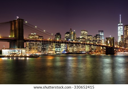 View of the Brooklyn Bridge at night from Brooklyn NY. Brooklyn Bridge at Night. City lights and Brooklyn Bridge at night.