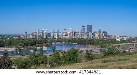 View of the Calgary skyline looking west. Deerfoot trail is in the foreground in front of the Bow River.