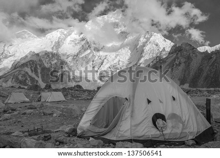 View of the camp of climbers on Khumbu glacier near near Gorak Shep village with Everest in the background - Nepal, Himalayas (black and white) - stock photo