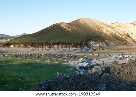 View of the campground in Landmannalaugar with colorful tents from above, Iceland - stock photo
