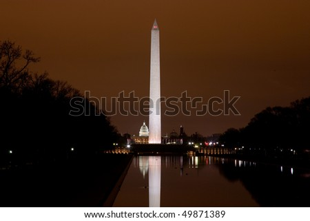 View of the Capitol Building and Washington Monument from the steps of the Lincoln Memorial in the evening