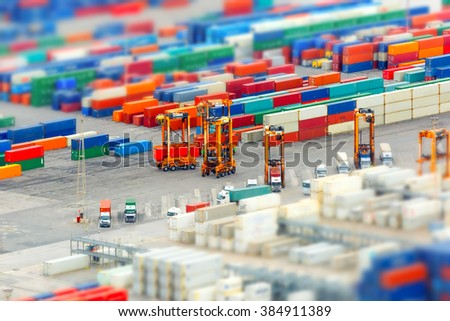 View of the cargo port and container terminal of Barcelona with the Montjuic hill, Barcelona, Catalonia, Spain. Shallow depth of field. - stock photo
