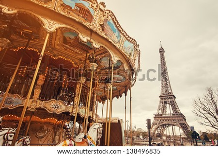 View of the carousel and the Eiffel Tower at sunset - stock photo