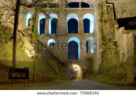 View of the Castle wing in Cesky Krumlov at night; the city is part of   UNESCO heritage. - stock photo