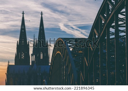 View of the cathedral and Hohenzollern Bridge in Cologne, Germany - stock photo