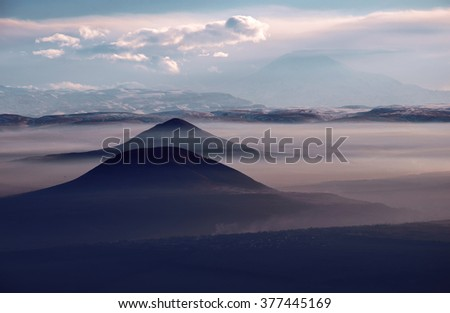 View of the Caucasian ridge and the mountains in the lilac haze - stock photo