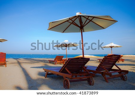 View of the chairs and umbrellas on the beach