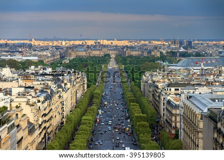 View of the Champs-Elysees with the Louvre in the background, seen from the Arc de Triomphe in the afternoon - stock photo