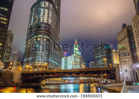 View of the Chicago River and skyscrapers in downtown Chicago as seen at night - stock photo