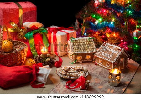 View of the Christmas table with presents and a Christmas tree - stock photo