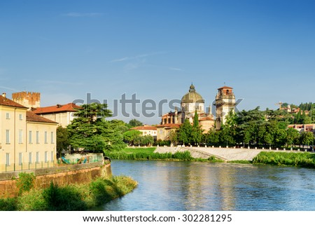 View of the Church of San Giorgio in Braida from the Adige River in Verona, Italy. Verona is a popular tourist destination of Europe. - stock photo