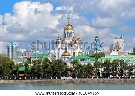 View of the Church on Blood, the Church of Christ's Ascension and the Patriarch's Metochion from the city pond of Yekaterinburg, Russia - stock photo
