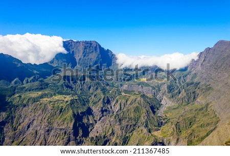 View of the Cirque de Mafate with clouds from the Maido, Reunion Island, France - stock photo