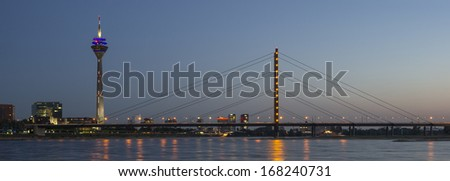 View of the city and the television tower Rheinturm in Dusseldorf in Germany at night - stock photo