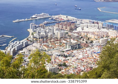 view of the city below, the ocean and the beach from the height of the Rock of Gibraltar, Gibraltar - stock photo