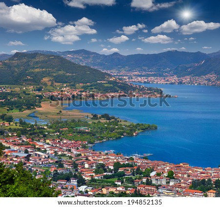View of the city Iseo, a bright sunny day. Italy, the Alps, Lake Iseo. - stock photo
