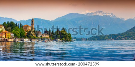 View of the city Mezzegra, Via Statale, Tremezzo CO, Alps, Italy. Colorful evening on the Como lake, Geolocation 45.982351,9.219718 - stock photo