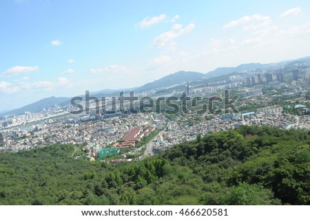 view of the city of Seoul, South Korea, blurred and low key