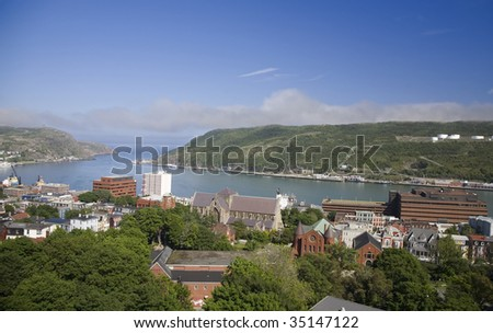 View of the city of St. John's and the harbour in Newfoundland, Canada. - stock photo