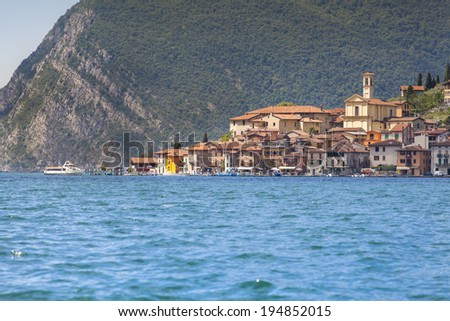 View of the city Predore, a bright sunny day. Italy, the Alps, Lake Iseo. - stock photo