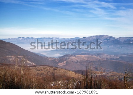View of the city Sarajevo in fog - stock photo