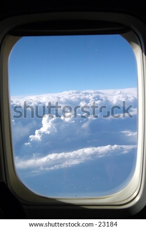 View of the clouds from an airplane window - stock photo