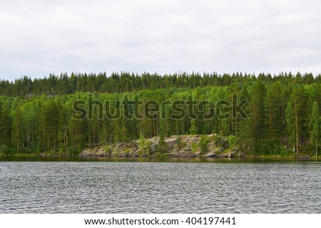 View of the coast of Lake Onega from quickly rushing boat