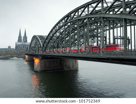 View of the Cologne Cathedral and railway bridge in a rainy day,Cologne,Germany - stock photo