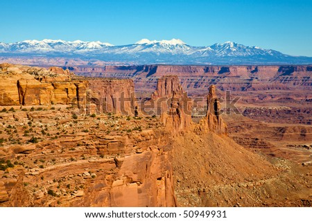 View of the Colorado River canyon and La Sal mountains, from Mesa Arch. Canyonlands National Park, near Moab Utah. - stock photo