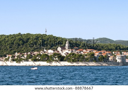 View of the Croatian island of Korcula from sea - stock photo