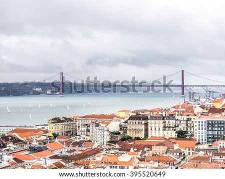 View of the 25 de Abril bridge from the Sao Jorge Castle - stock photo
