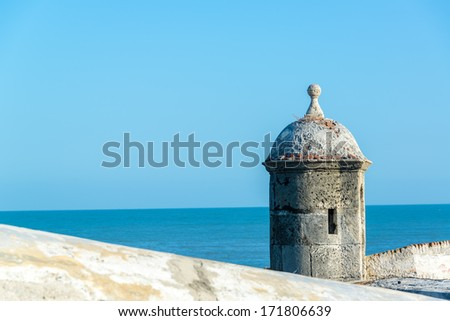 View of the defensive wall surrounding the old city of Cartagena, Colombia with the Caribbean Sea visible in the background - stock photo