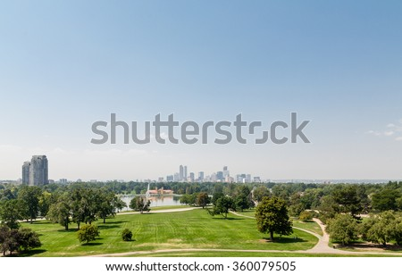 View of the Denver skyline across green park - stock photo