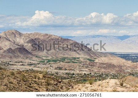 view of the desert valley from the top of a mountain in southern California, green Golf Courses in the desert. - stock photo