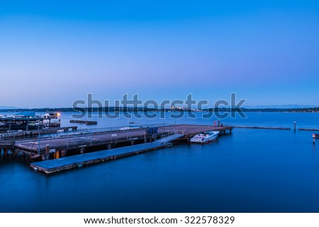 view of the dock in lake Washington with back ground skyline of Bellevue  from Lake Washington,Usa.