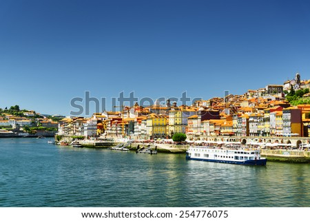 View of the Douro River and colorful facades of houses of the historic centre of Porto, Portugal. It is one of the most popular tourist destinations in Europe. - stock photo