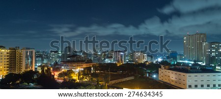 View of the downtown area of the city of Dar Es Salaam, Tanzania, at night - stock photo