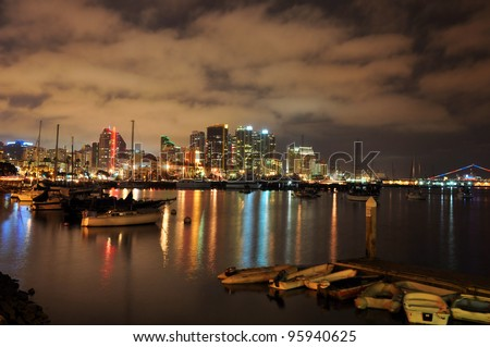 View of the downtown San Diego skyline and harbor at night in Southern California. - stock photo