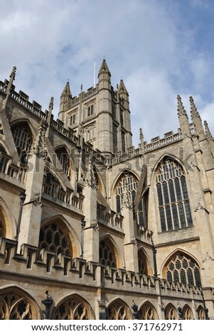 View of the Exterior and Steeple Tower of the Historic Bath Abbey in Somerset England - The Anglican Parish Church is Officially Referred to The Abbey Church of Saint Peter and Saint Paul - stock photo