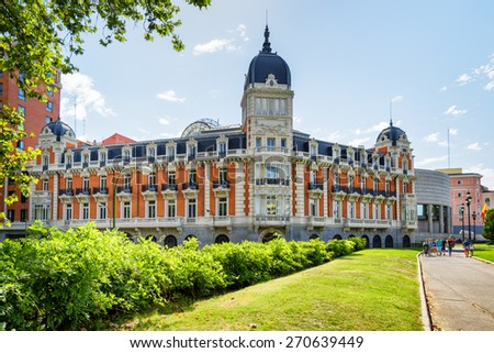 View of the facade of building on the Square of Spain (Plaza de Espana) in Madrid on the blue sky background in Spain at summer time. Madrid is a popular tourist destination of Europe. - stock photo