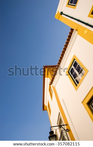 view of the facade of the building of Evora during a sunny day, unesco heritage site. portugal - stock photo
