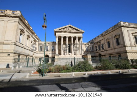 View of the facade of the palace of justice of Montpellier France, located in Foch street. Historical building with 6 tall columns. Front green gate closed. Urban picture taken on 27 january 2018.