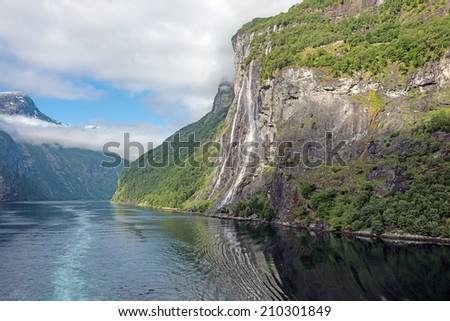 View of the famous Seven Sisters Waterfall in the beautiful Geiranger Fiord, Norway - stock photo
